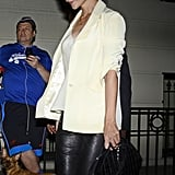 Katie Holmes layered a white shirt with a white blazer.