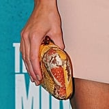 Kate Beckinsale opted for an unexpected citrus-hued exotic minaudière.