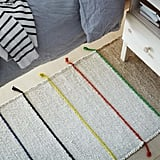 Made from handwoven jute, this durable rug ($30) offers a refreshing pop of color.