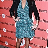 Kristin Chenoweth contrasted a busy print dress with chic black accompaniments, and it worked.