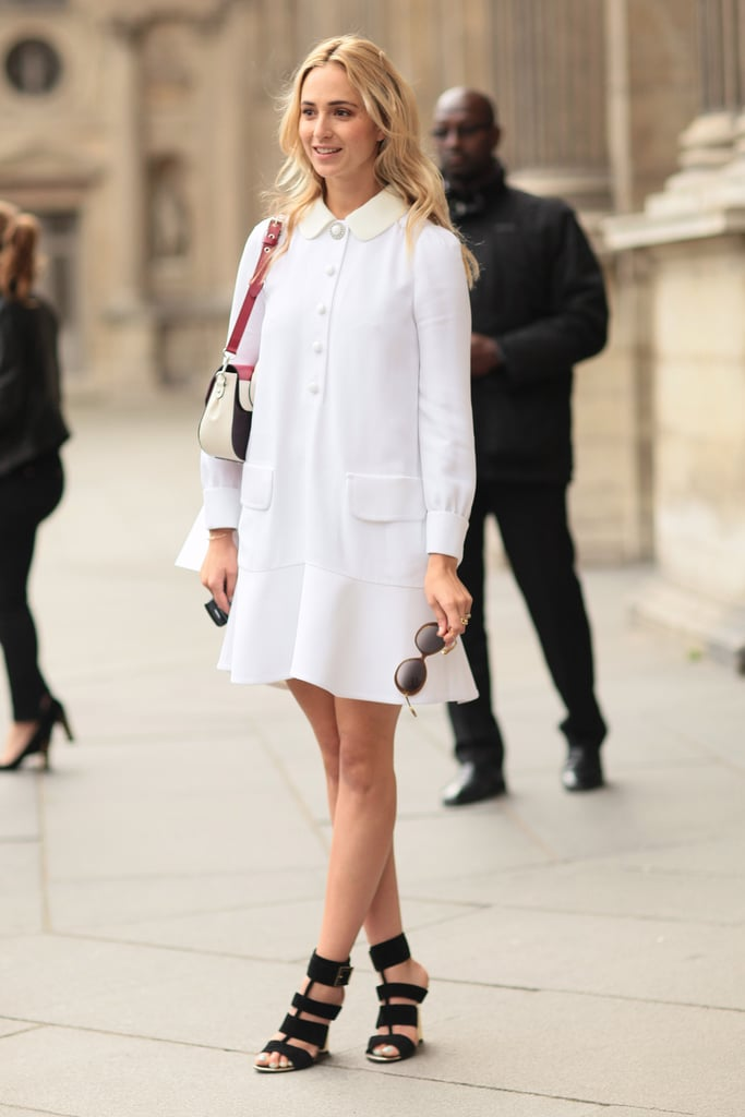 A sweet white collared dress looked just a little edgy with strappy heels.