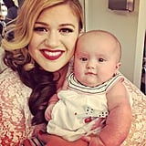 """River is visiting me on the set of my new music video shoot for Wrapped In Red! #babysfirstvideo"""