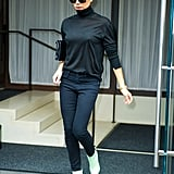 Victoria added a pop of colour to her dark outfit with pastel green ankle boots.