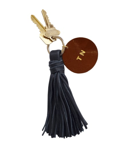 For a sweet option that won't break the bank, try Clare V.'s tassel key chain ($65 with personalization) with a disc ready for customizing.