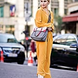 Let a pair of soft trousers skim the top of the boot, flashing the full silhouette as you walk down the street.