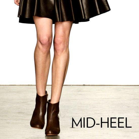 Why we love them: Not everyone loves a sky-high heel — and even if you do, some days you just need a break from totally towering. Enter the mid-heel boot: an equally-chic alternative, perfect for wearing on the weekends, or when five-inchers aren't proving practical. How to wear them: Mid-heel boots can work well with anything from jeans to dresses, and are ideal for wearing with a mini skirt — you'll get a little bit of height without looking too va-va-voom.  Shop the runway: Rachel Comey Petra Boot ($438)