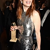 Julianne Moore showed off her statue at the HBO party.