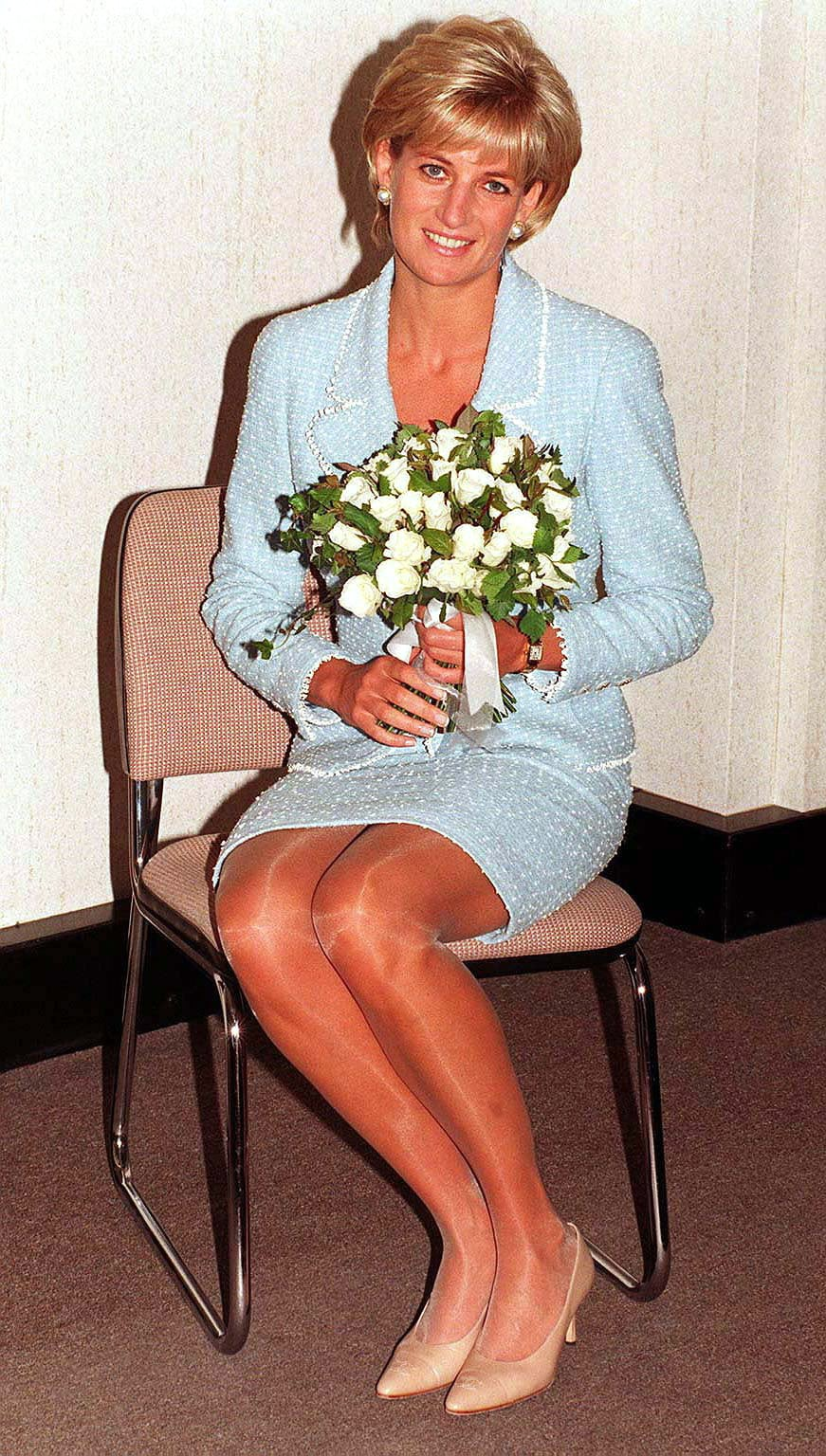 LONDON - APRIL 21: Diana, Princess of Wales is presented with the first rose to be named after her at the British Lung Foundation offices on April 21, 1997 in London, England. It is hoped that sales of the rose, which goes on public display for the first time at the Chelsea Flower Show next month, will raise thousands of pounds for research into lung diseases. (Photo by Anwar Hussein/WireImage)