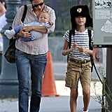 Jennifer Connelly held Agnes Bettany and Stellan Bettany wore a hat in NYC.