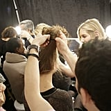Hair, by Ted Gibson (for Beauty.com), was gathered high to create the base for the contemporary updo. Photo: Megan Holmes