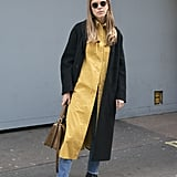 Work all of your neutrals with a mustard-toned dress that will pop against your jacket.