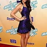Nina channeled her sultry sensibility in a slick purple dress and black sandals in July 2008.
