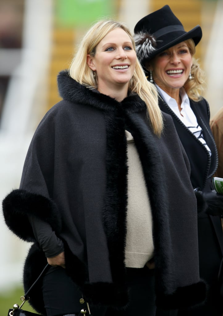 A pregnant Zara Phillips bundled up to take in the Paddy Power Gold Cup.