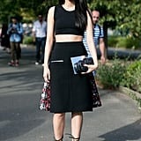 She got the memo on crop tops and lace-up heels, adding both to her Preen by Thornton Bregazzi skirt.