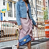 Outfit details: POPSUGAR at Kohl's Denim Jacket ($48, originally $64), Donna Mizani wrap dress, and Ash Addict Sneakers ($280)