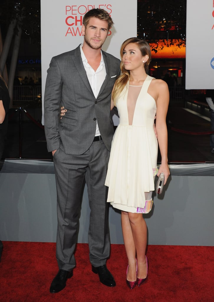 Miley Cyrus gave Liam Hemsworth a sweet glance on the carpet in 2012.