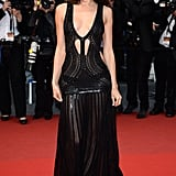 Irina Shayk didn't shy away from showing major skin at the All Is Lost premiere. Between the deep plunging neckline and the cut-outs, it was nothing short of sexy.