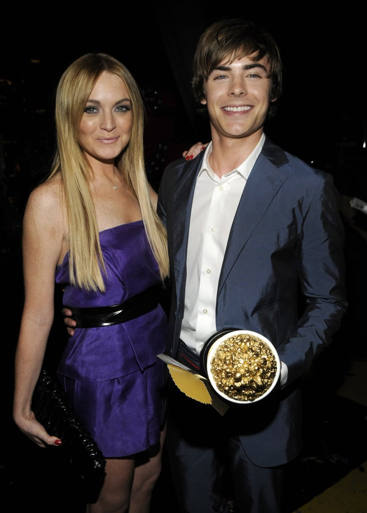 Lindsay Lohan posed with Zac Efron and his golden popcorn in 2008.