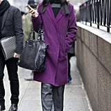 The best accessory for a bright purple jacket? A similarly shaded lipstick, like this woman showcased.