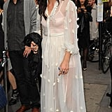 Daisy wore a white vintage inspired lace maxi dress.