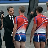 France's President Nicolas Sarkozy meets with two firemen performers at the Bastille Day parade on the Champs-Elysees.
