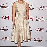 At the AFI Awards luncheon in Beverly Hills, CA, Emilia exuded ladylike glam in a metallic fit-and-flare dress and nude pumps.