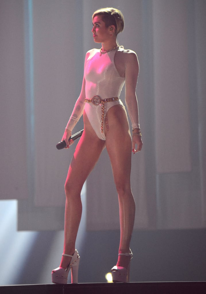 "Miley Cyrus wore a white leotard to perform ""Wrecking Ball"" at the MTV EMAs."