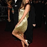 Melania stole the show at the 2007 Met Gala in her Roberto Cavalli flapper-inspired dress. She wore open-toed Manolo Blahnik heels — also metallic.