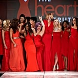 Kelly Osbourne led her fellow celebrities in a celebration after walking the runway at The Heart Truth's Red Dress fashion presentation.