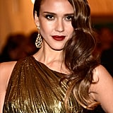 At the 2012 Met Gala, Jessica was a vintage vision in vampy brick lipstick and side-swept waves.