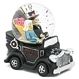 Skeleton Driving a Car Globe With Music