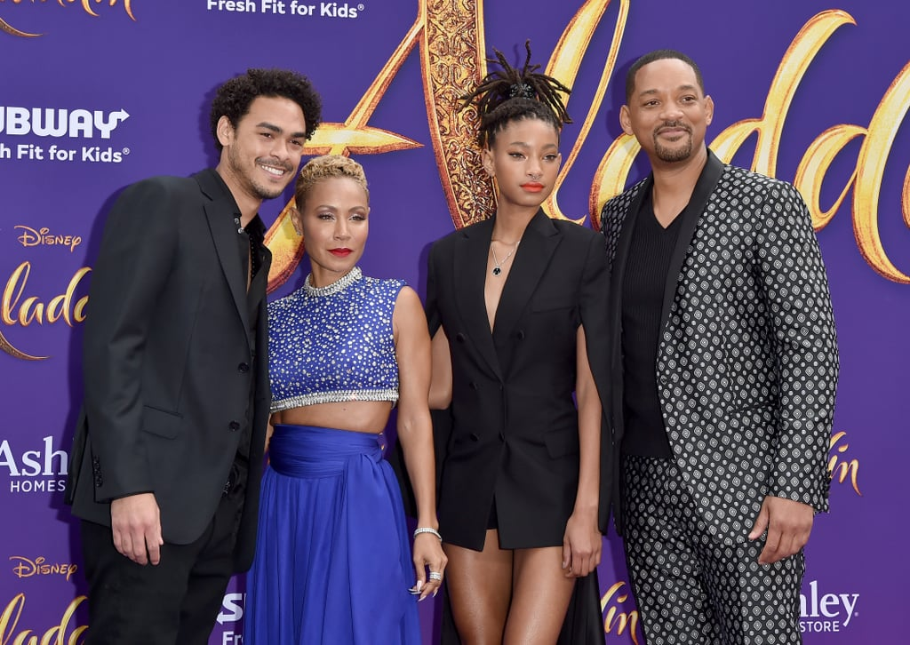 It was a Smith family affair at the Los Angeles premiere of Aladdin on Tuesday. Will Smith, 50, was joined by wife Jada, 47, and his three children — Trey, 26, Jaden, 20, and Willow, 18 — at the event. While Will rocked a patterned suit, Jada modeled a Genie-inspired look with a blue crop top and wide-legged pants as a nod to her husband's role in the film. Trey and Jaden also looked dapper in all-black suits, and Willow stunned in a one-piece blazer dress. The quintet appeared to be having a blast on the purple carpet as they all posed, embraced, and kissed each other. Jada especially had fun showing off her flowy pants with hilarious poses, and Will jokingly tried to cover Willow, who was effortlessly showing off her legs. But what can we say? Comedy (and general talent) just runs in the family!      Related:                                                                                                           Will Smith's Genie in Aladdin Was Actually Inspired by 1 of His Most Famous Roles