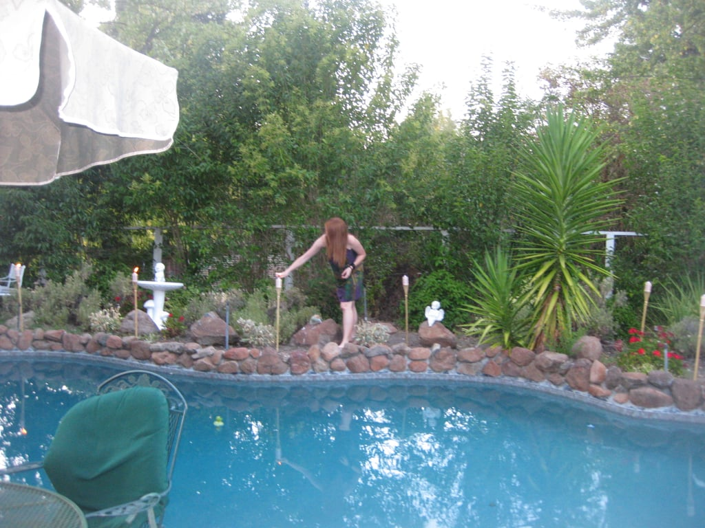 My sister lights the tiki torches. This can only mean one thing: it's almost time for the guests to arrive!