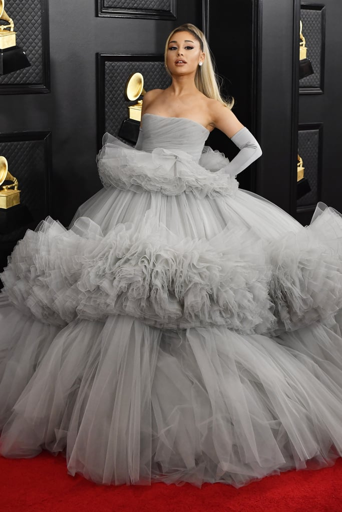"Ariana Grande took the Grammy Awards by storm on Sunday night when she walked the red carpet wearing a voluminous cloud gray Giambattista Valli ballgown. The ""Thank U, Next"" singer celebrated her many nominations with her parents by her side, and totally brought the drama as she posed for photos. Hey, when you have a massive tiered skirt, you have to show it off, right?  Ariana paired the strapless tulle gown with matching gloves, glittering diamond studs, and a blonde high ponytail — an outfit totally worthy of a pop princess! Shortly after, she switched things up and changed into a complementary silver set with another ginormous skirt and gloves. But she didn't stop there. Toward the end of the show, Ariana gave an emerald green ballgown a try while sitting in the audience. Whew, I can barely keep up. Keep reading for more glimpses of all her glam looks.       Related:                                                                                                           We Are in Awe of these 2020 Grammys Red Carpet Looks — See the Best Outfits Now!"