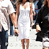 In another shot from the set of The Bounty in 2009, Jennifer looked summery and fresh in a white knee-length dress and her Stuart Weitzman crochet Alex wedges.