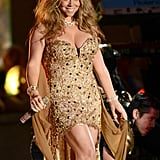 Mariah Carey wore a gold dress to perform at the NFL Kickoff concert in NYC.