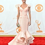 The silhouette of Julie Bowen's pale pink Zac Posen gown was absolutely breathtaking. To carry her necessities, the actress chose a Marchesa clutch. For glitz, she went with Jacob & Co. diamond studs and a bracelet that weighed in at 20 carats.