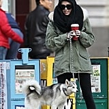 Miley Cyrus was bundled up in a black scarf and parka.