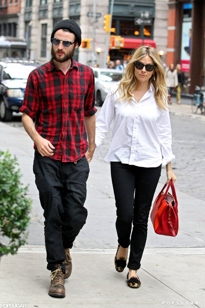 Tom Sturridge held on tight to Sienna Miller's hand in October when they made their way into their NYC hotel.