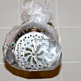 The showerhead may not be something you think about cleaning very often. Over time, mineral deposits build up on the showerhead. Surprisingly, it may also have biofilm (or yucky slime, to be really technical) on it and blast bacteria on you every time you take a shower. Pour vinegar in a plastic bag. Secure it to the showerhead with a rubber band. Let it sit overnight. The next morning, take the bag off and scrub the showerhead with a scrub brush.