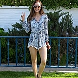 A watercolor Nordstrom romper was complete with a delicate hemline and accented by a pair of go-to Nordstrom sandals.