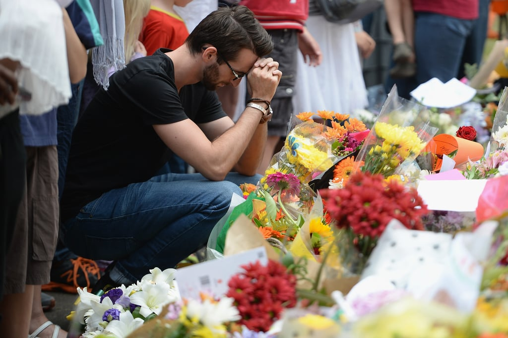 A man knelt in prayer during the public memorial at Nelson Mandela's Houghton home.