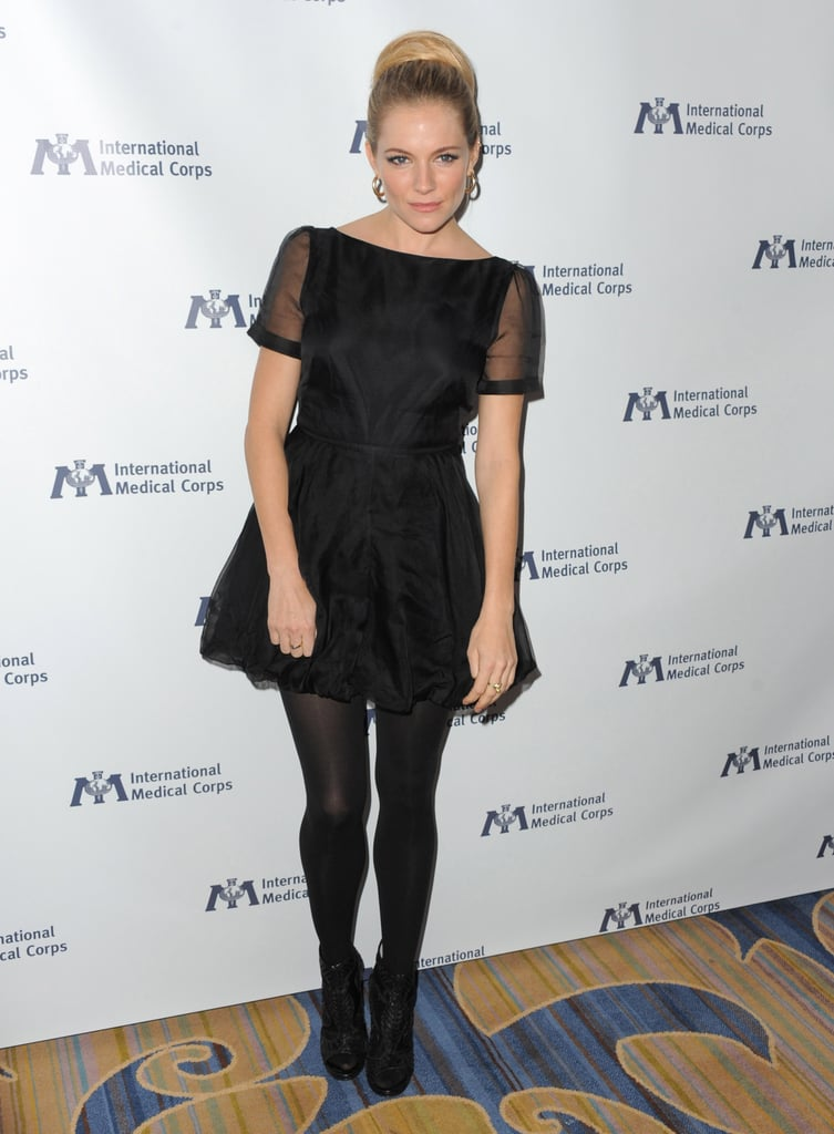 Sienna Miller picked a classic LBD, from her own line Twenty8Twelve, for the International Medical Corps' awards celebration in Beverly Hills last night. She was recognized for her work in Haiti and Ethiopia. Her boyfriend missed out on the soiree, though Sienna and Tom Sturridge took romantic trip to Venice just last week.  Sienna's visit to the West Coast may give her time to catch up with pal Kristen Stewart. Kristen's currently nursing a torn ligament in her right hand while Robert Pattinson and Taylor Lautner hit the talk show circuit in NYC. Kristen, Rob, and Taylor will be back together on Monday night for the big Breaking Dawn Part 1 premiere, but we'll have to wait and see if Sienna and Tom step out to support their friends. Kristen may be spending lots of time with Tom, who's both Sienna's man and Rob's best friend, in the new year when the pair promote their Kerouac classic On the Road.