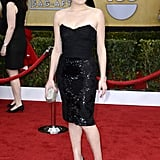 Elisabeth Moss showed a little leg in a sequined Dolce & Gabbana LBD, black Christian Louboutin pumps, a sparkling Jimmy Choo clutch, and $1 million diamond earrings.