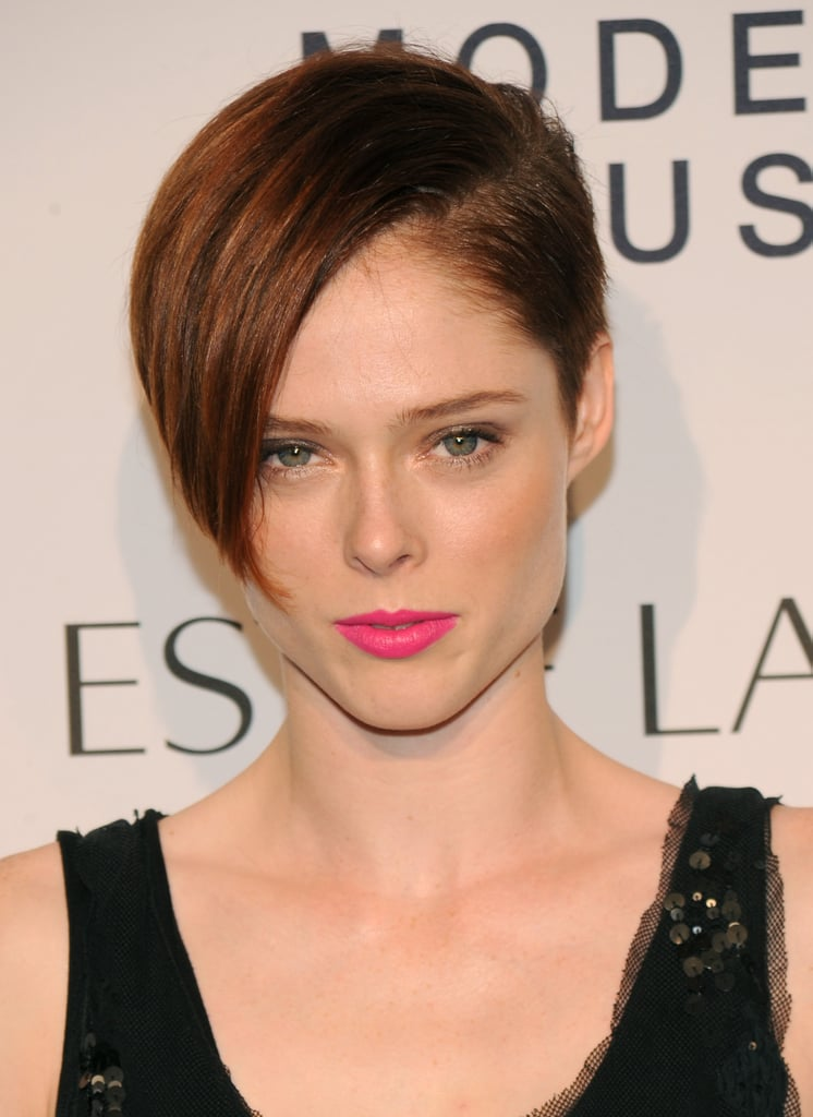 Just when we thought Coco Rocha's asymmetrical pixie would always take center stage, she throws on a swipe of neon pink lipstick.