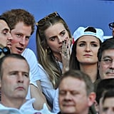 Harry and Cressida got close at a rugby game in March.