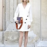 Candela Novembre kept cool wearing a Redemption Choppers dress paired with sandals and a Marni bag.