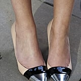 Silver peep-toe pumps provided a shimmery finish to this street-style look.