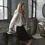 Wearing a Lanvin shirt, Oscar de la Renta pendant, Dolce & Gabbana skirt, and Chloé bag.