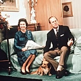 The royal pair sat with their pup at Scotland's Balmoral Castle in 1974.